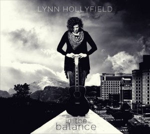 In The Balance with photo of Lynn Hollyfield and guitar