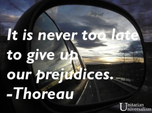 Car mirror reflecting sunset with text - it is never too late to give up prejudices by Thoreau